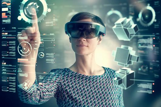 Woman wearing mixed reality smartglasses touching transparent screen.